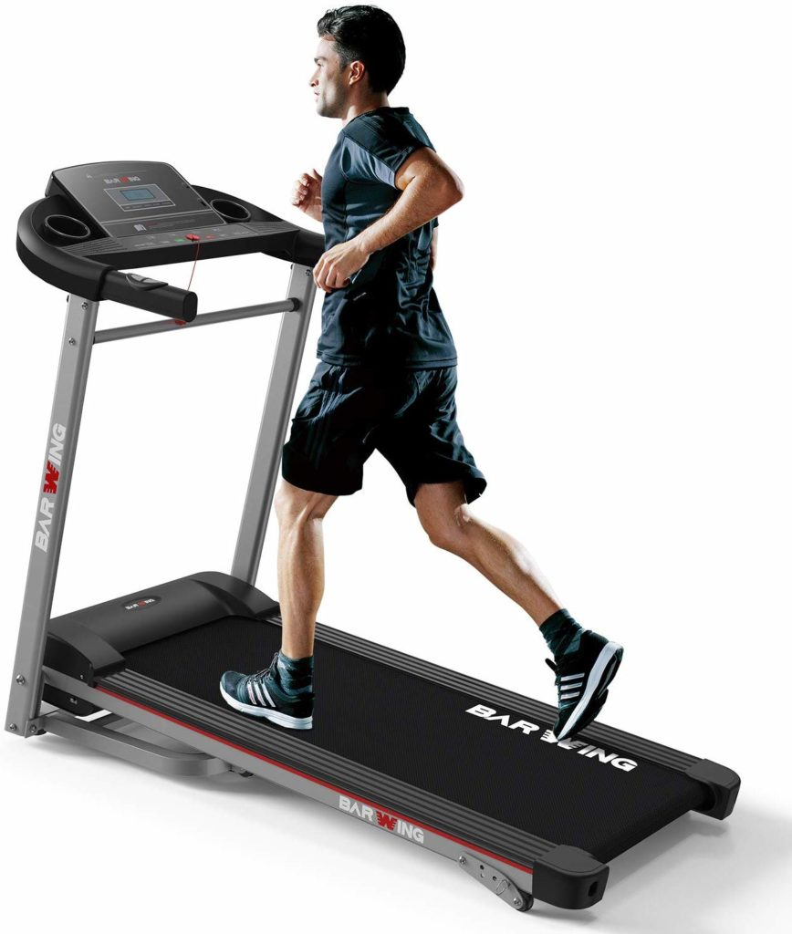 A man is running on the BARWING Electric Folding Treadmill