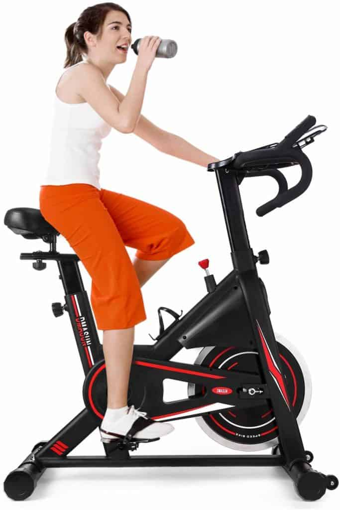 DMASUN Exercise Stationary Bike is being ridden by a woman