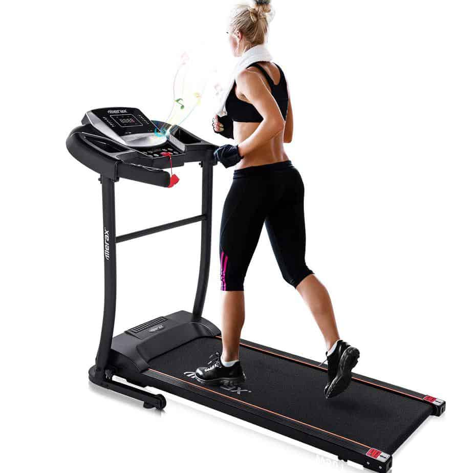 A lady is running on the Merax Folding Treadmill