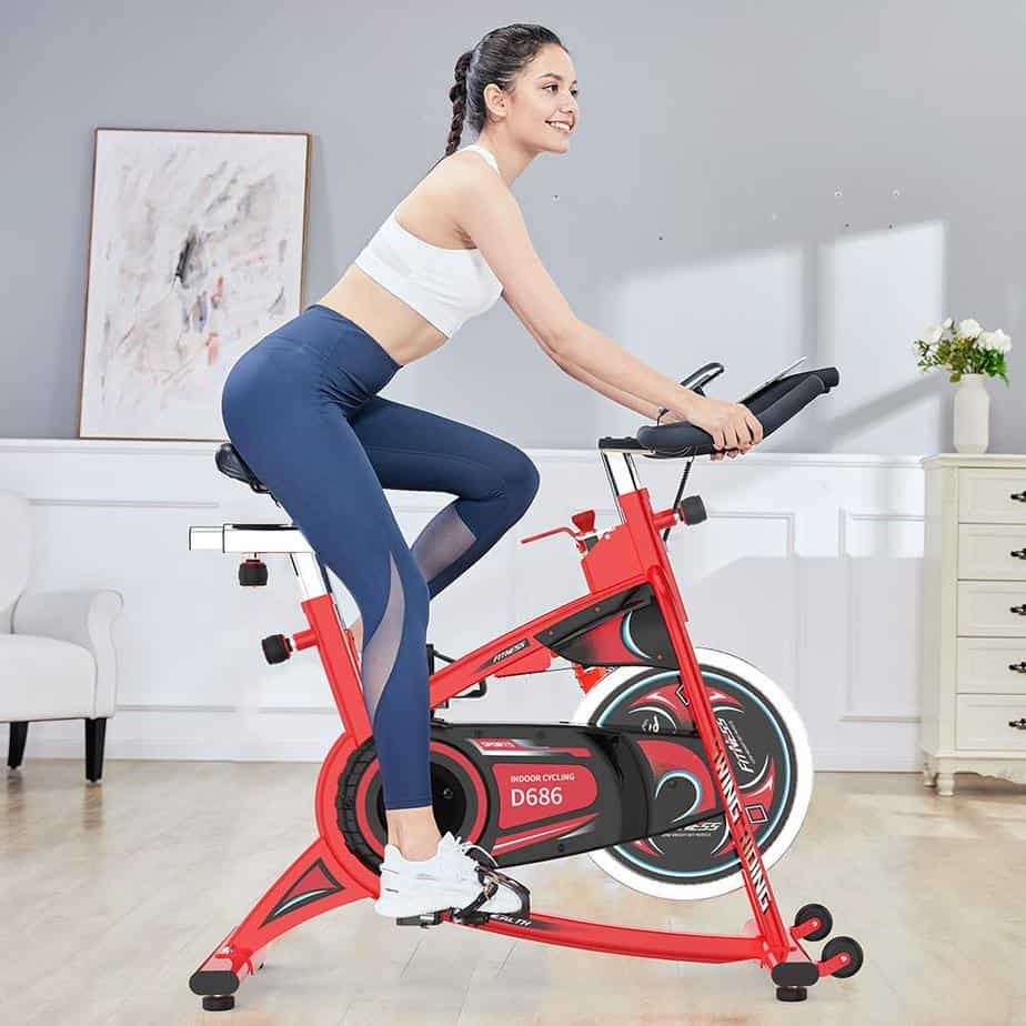 A lady rides the Pooboo D686 Indoor Cycling Bike