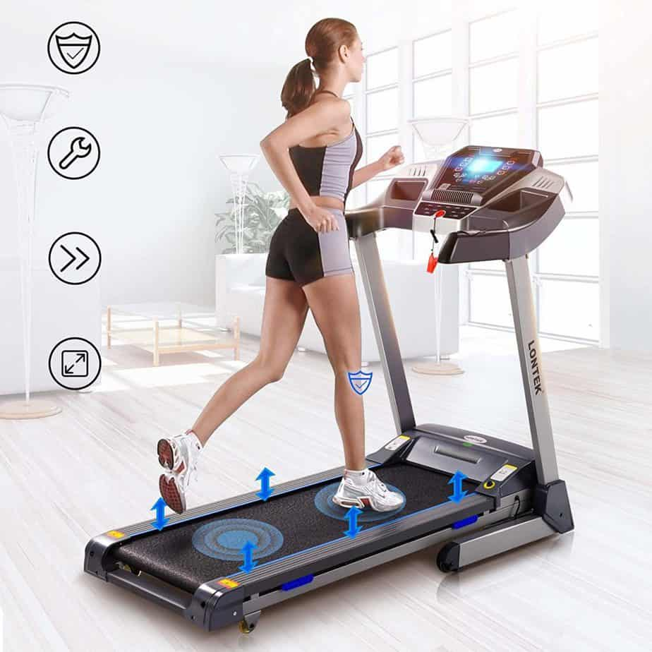 A lady is exercising on the UMAY Bluetooth Motorized Treadmill