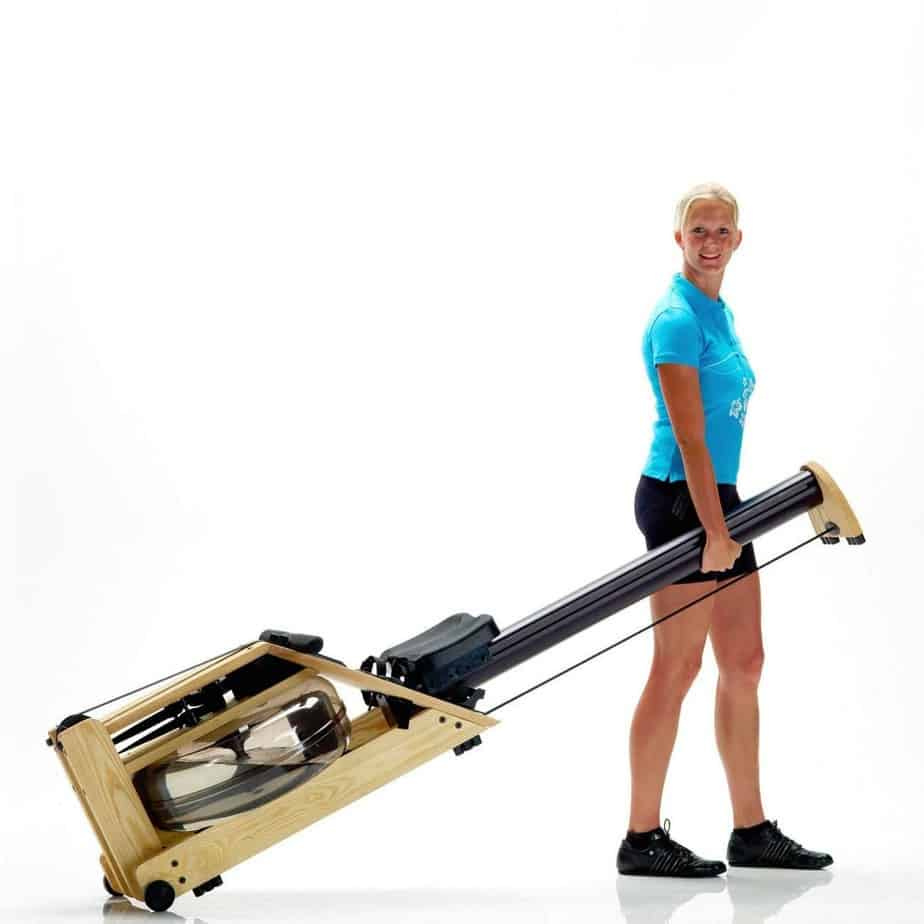 A lady moving the Waterrower A1 Studio Rowing Machine