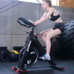 A lady athlete riding the Pooboo D578 Indoor Cycling Bike