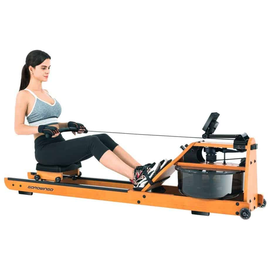 A lady is exercising with the Gorowingo Wooden Water Rower