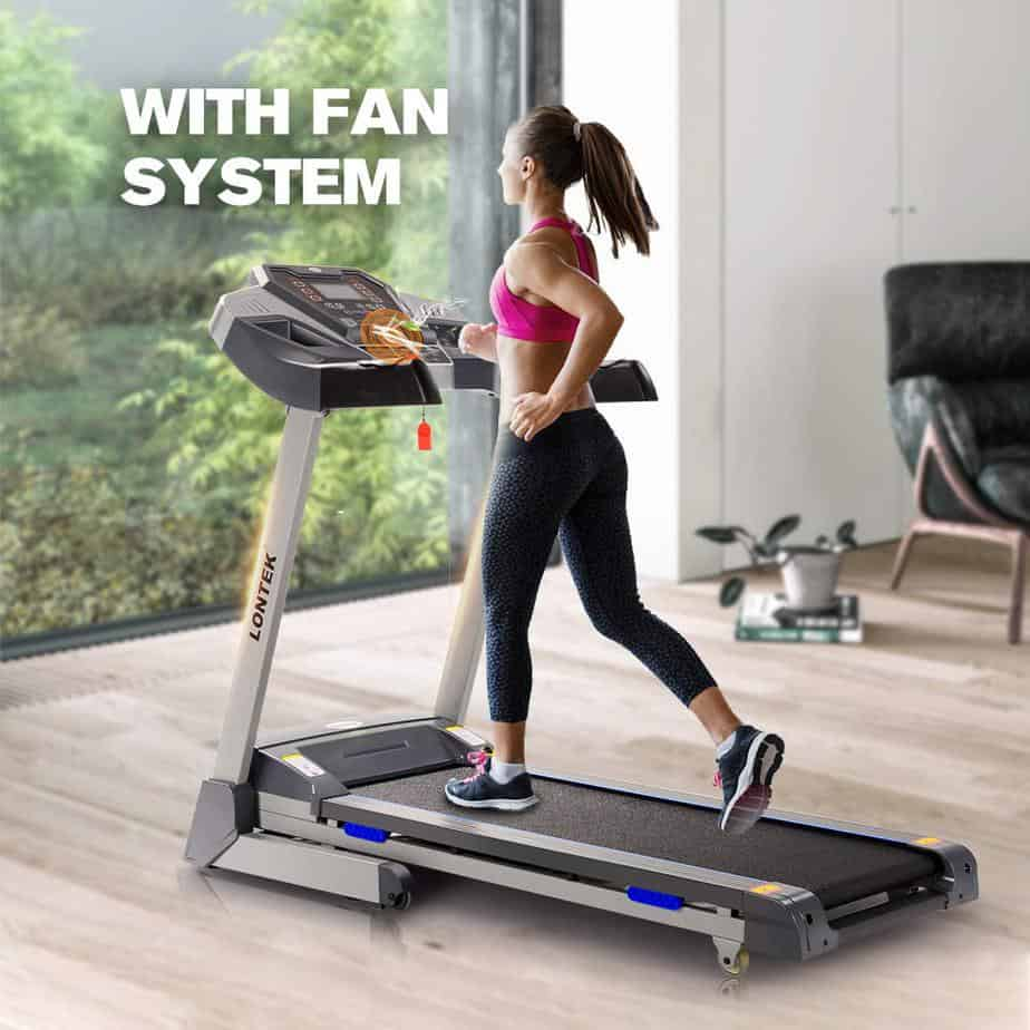 A lady is jogging on the UMAY Bluetooth Motorized Treadmill