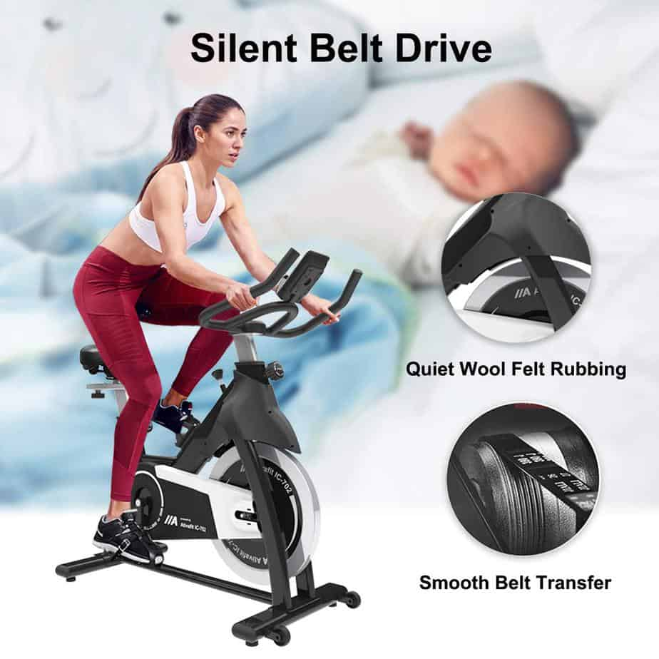 The Ativafit IC-702 Indoor Cycling Bike being ridden by a lady beside a sleeping baby