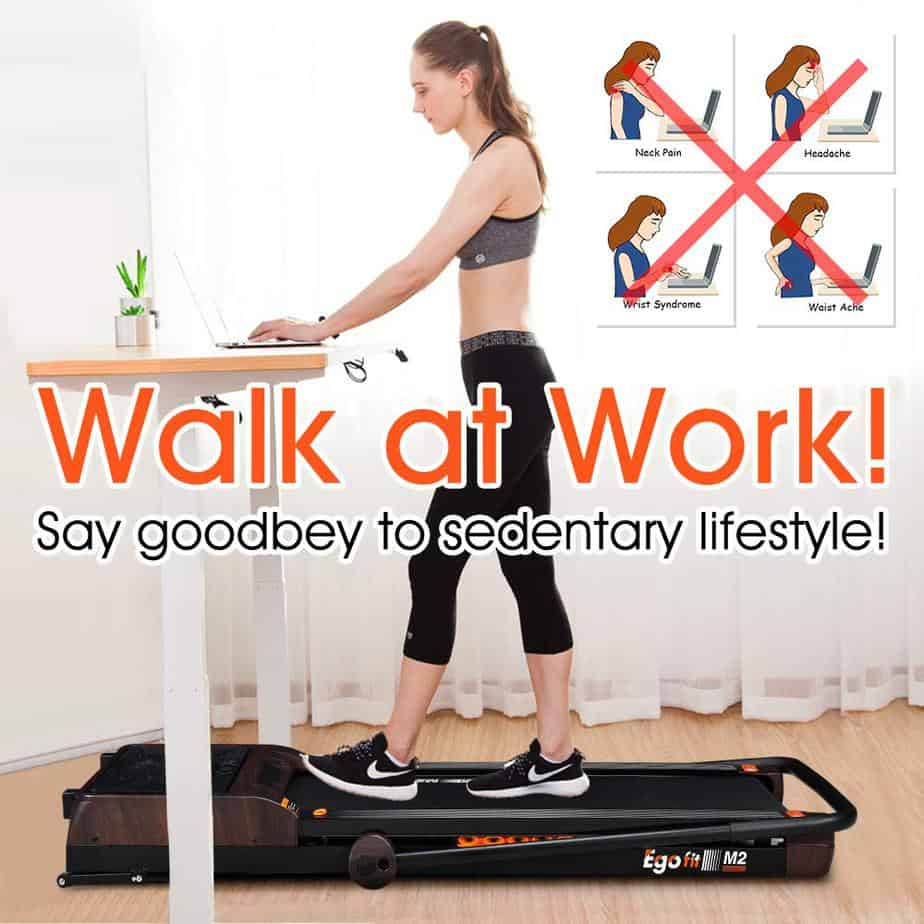 A lady walks and works on the Egofit M2 Treadmill
