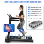 A lady is jogging on the Goplus Electric Folding Treadmill
