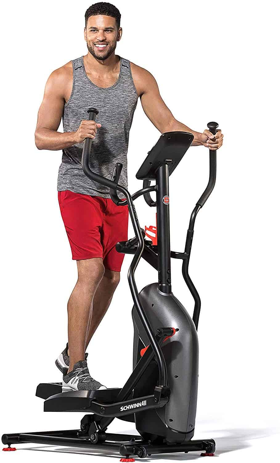 A man is exercising with the Schwinn 411 Compact Elliptical