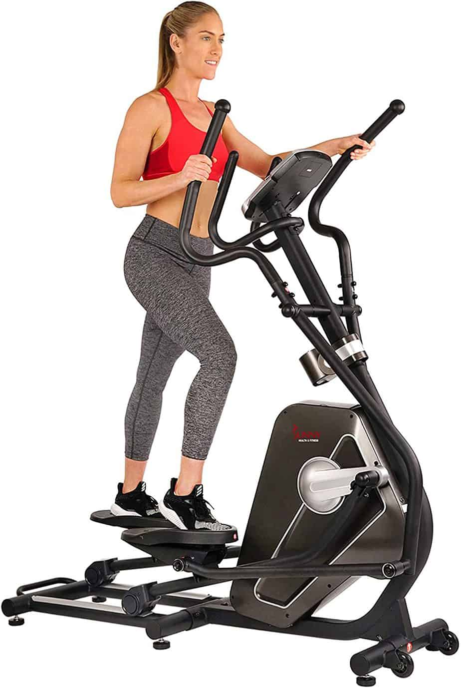 A lady is working out with the Sunny Health and Fitness SF-3862 Elliptical