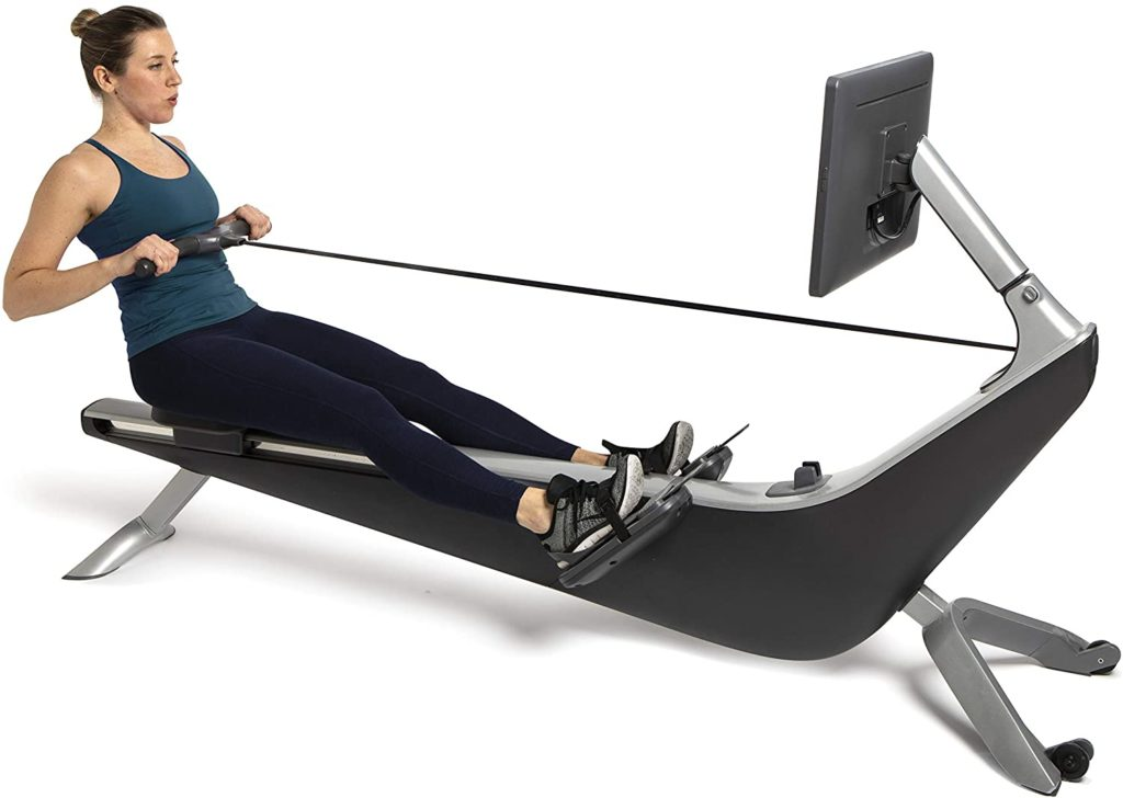 A lady athlete is working out with the Hydrow Live Outdoor Reality Rower