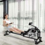 A lady rowing on the Maxkare Water Rowing Machine