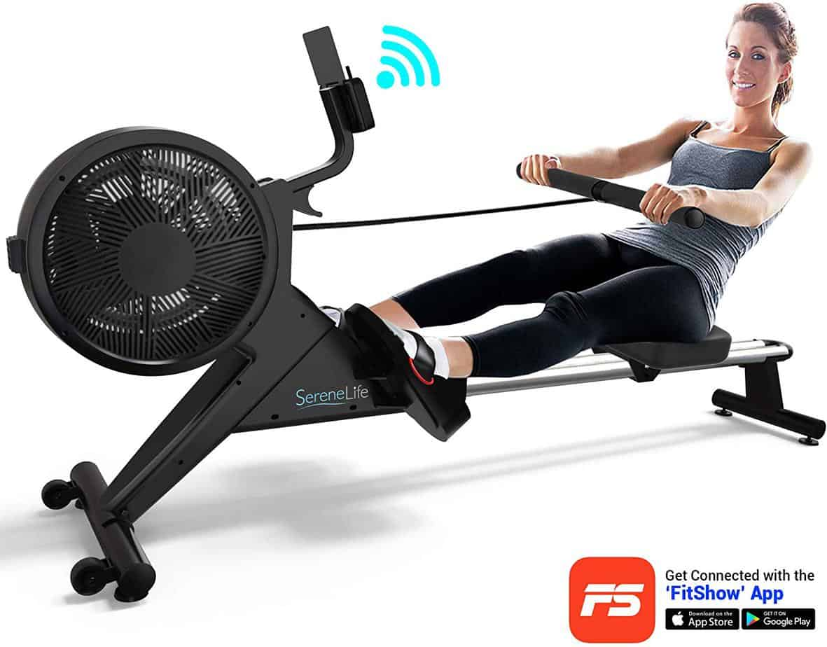 A lady is rowing with the SereneLife SLRWMC60 Smart Rowing Machine