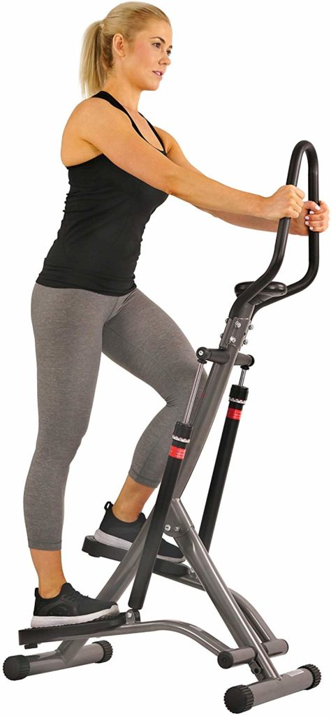 A lady is stepping on the Sunny Health and Fitness SF-1115 Folding Climbing Stepper