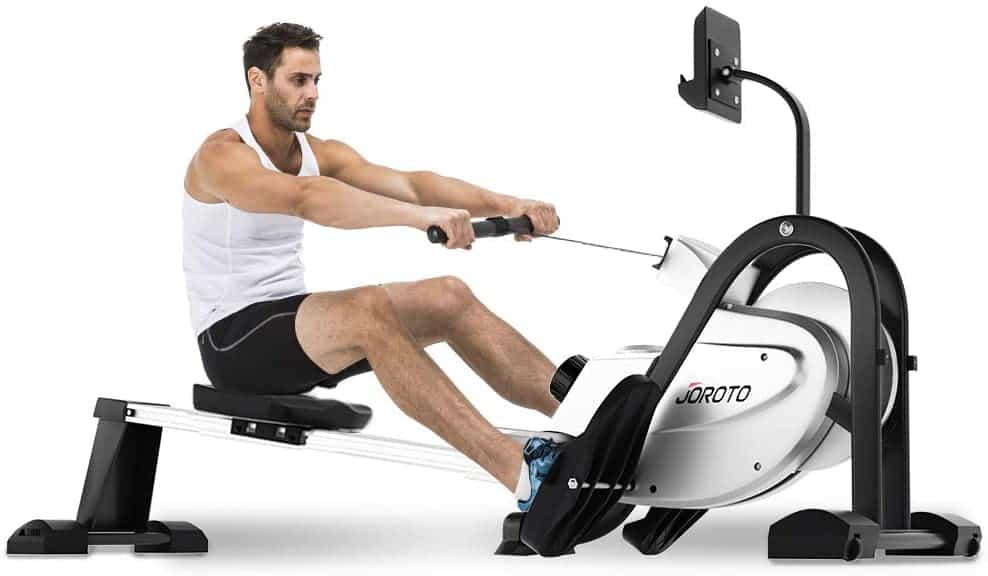 A man is rowing on the JOROTO MR35 Rowing Machine