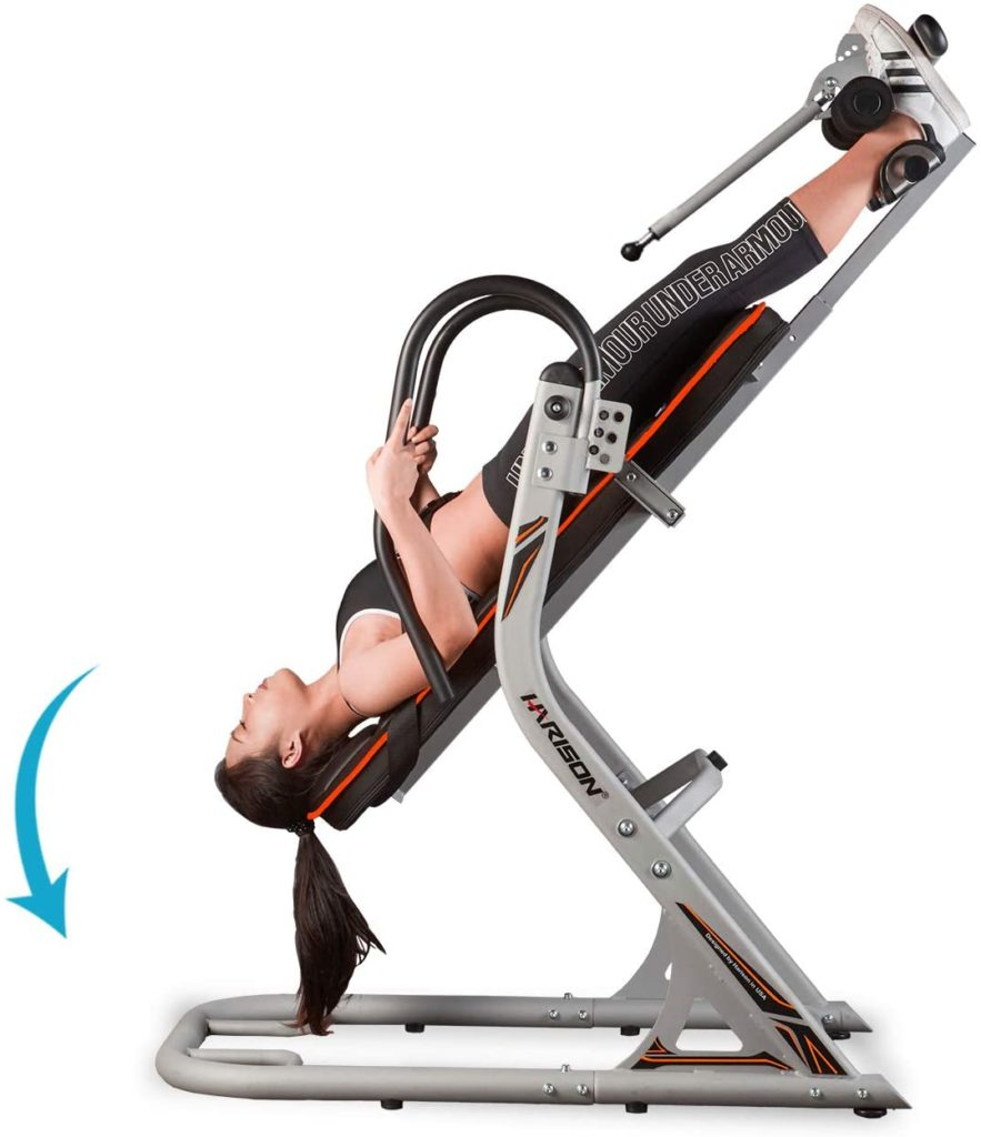 A lady exercising on the HARISON 407 Inversion Table