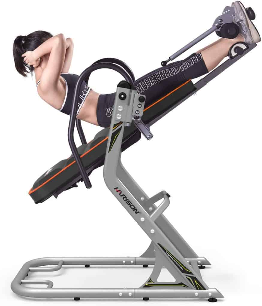 A lady is exercising on the HARISON 407 Inversion Table