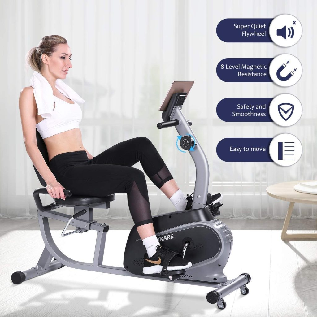 A lady is exercising with the MaxKare Recumbent Exercise Bike