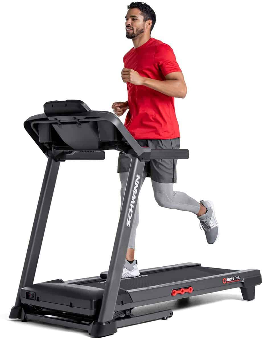 A man is running on the Schwinn 810 Treadmill Model 100799