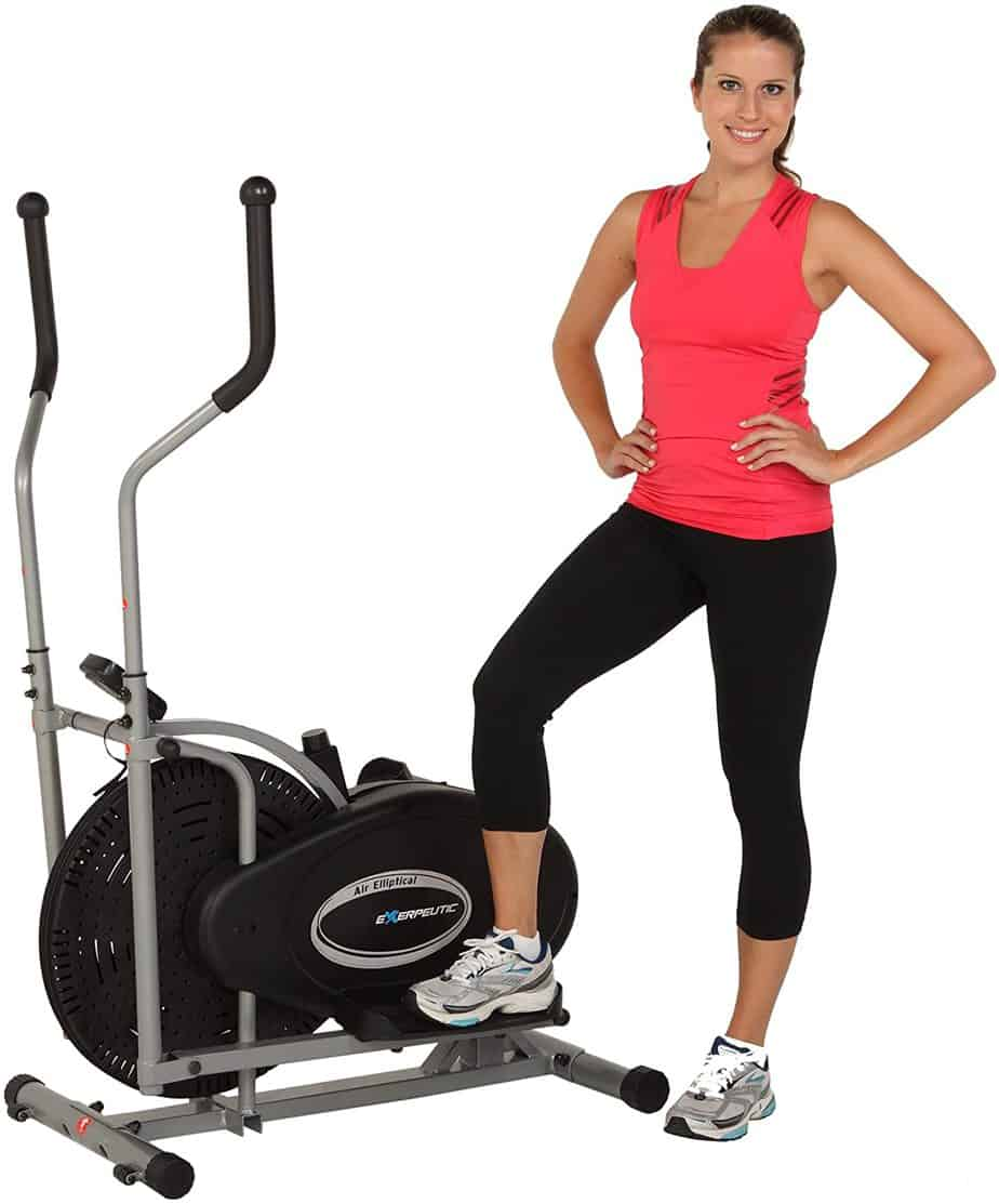 A lady standing by the Exerpeutic Aero Air Elliptical