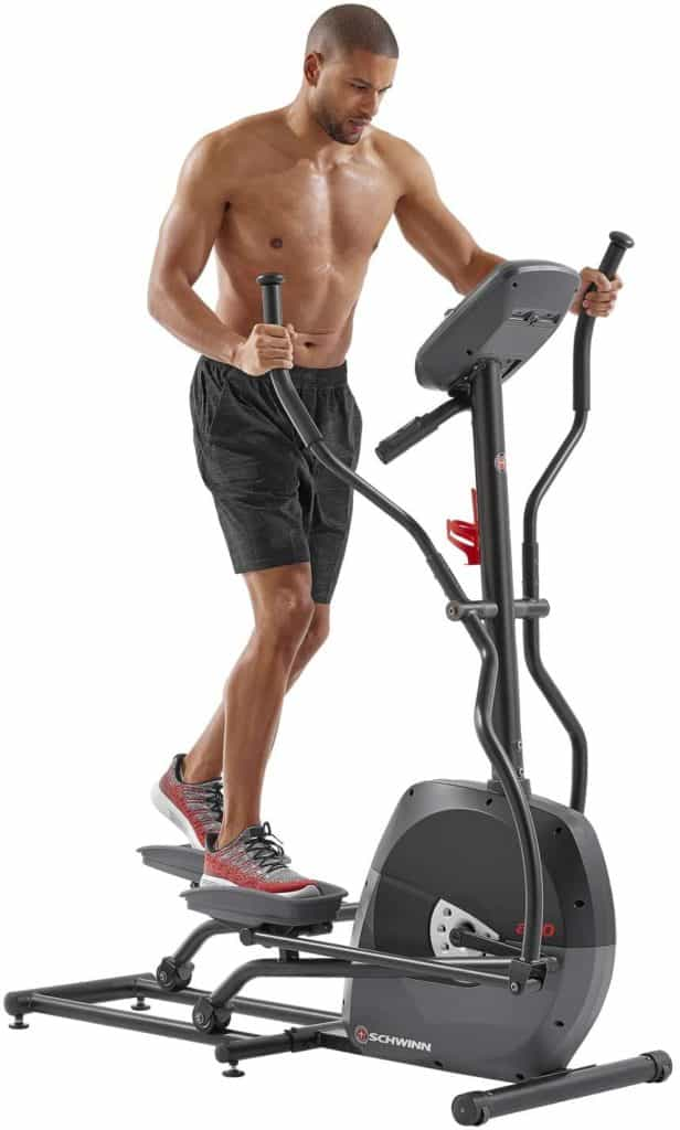 A man is working out with Schwinn A40 Compact Elliptical 100330