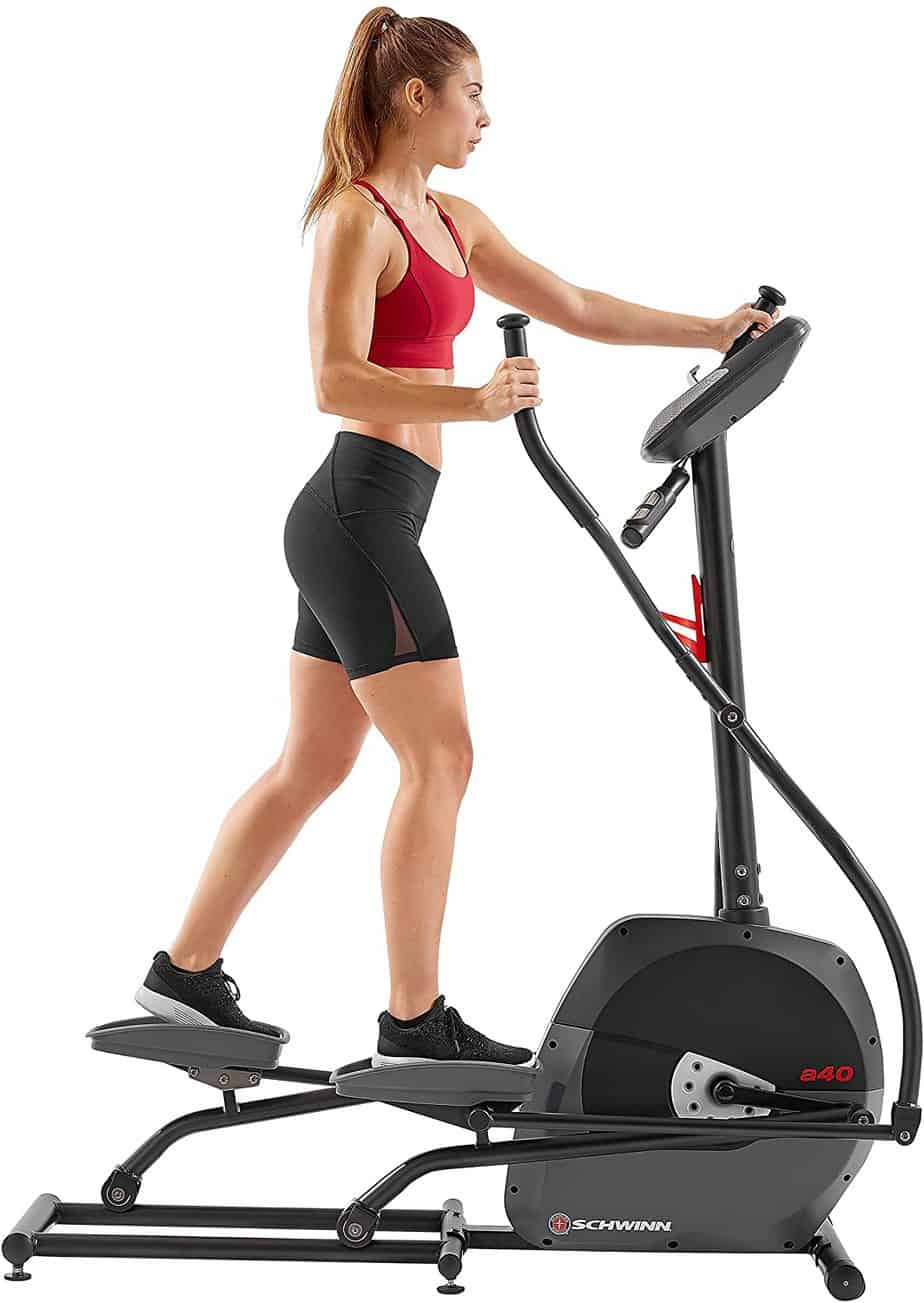A lady is working out with the Schwinn A40 Compact Elliptical 100330