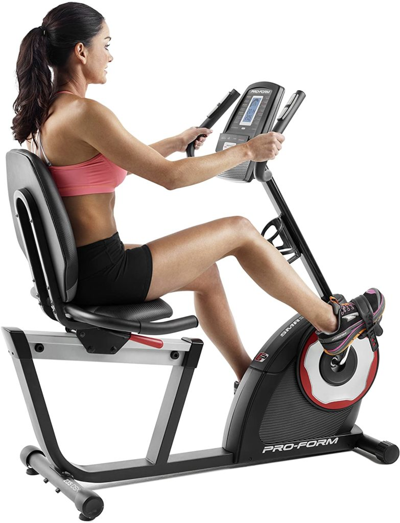 A lady exersing with the ProForm 235 CSX Recumbent Exercise Bike