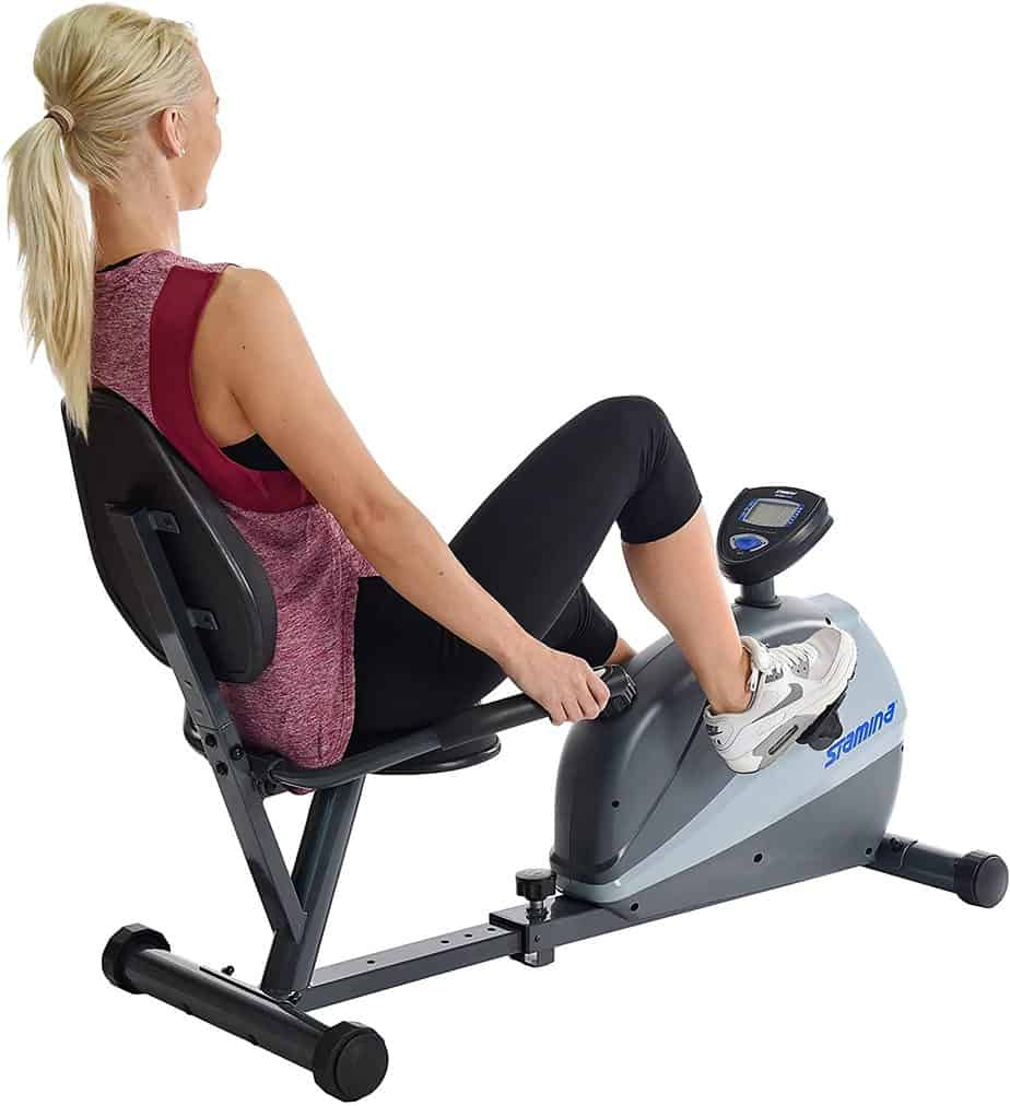 The Stamina 4831 Magnetic Recumbent is being ridden by a lady