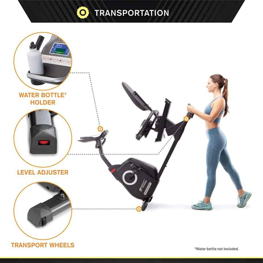 A lady rolls the Circuit Fitness AMZ-587R Magnetic Recumbent Bike away for storage