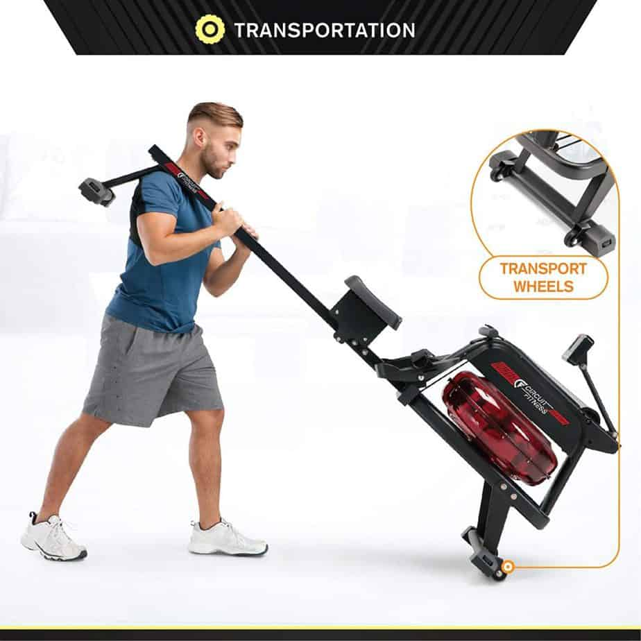 A man moving the Circuit Fitness AMZ-167RW Water Rowing Machine for storage