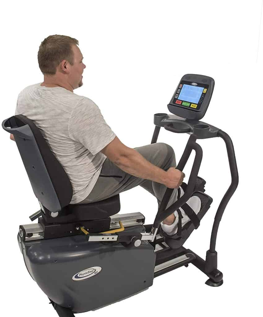 A man works out on the HCI Fitness PhysioStep RXT-1000 Recumbent Elliptical Trainer