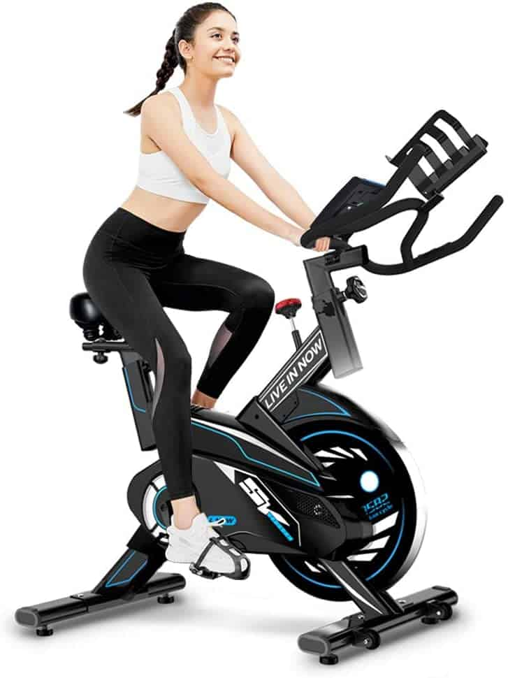 A lady is riding the L NOW 582 (S2) Indoor Exercise Bike