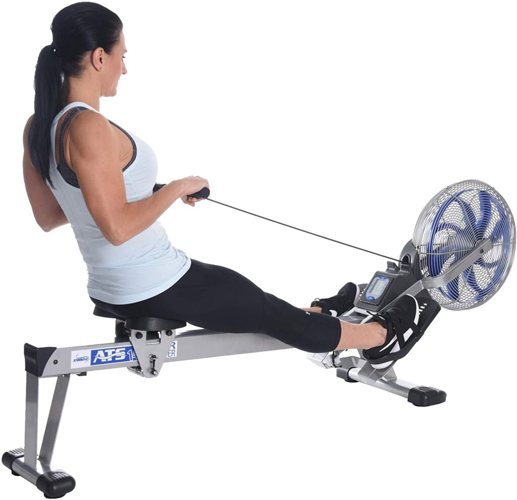 A lady is using the Stamina ATS 35-1405 Air Rower