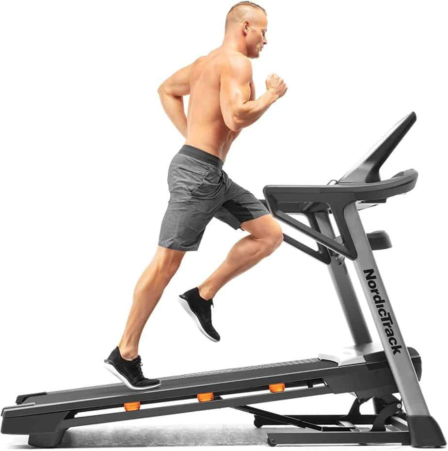 An athlete sprints on the Nordic Track T 9.5 S Treadmill