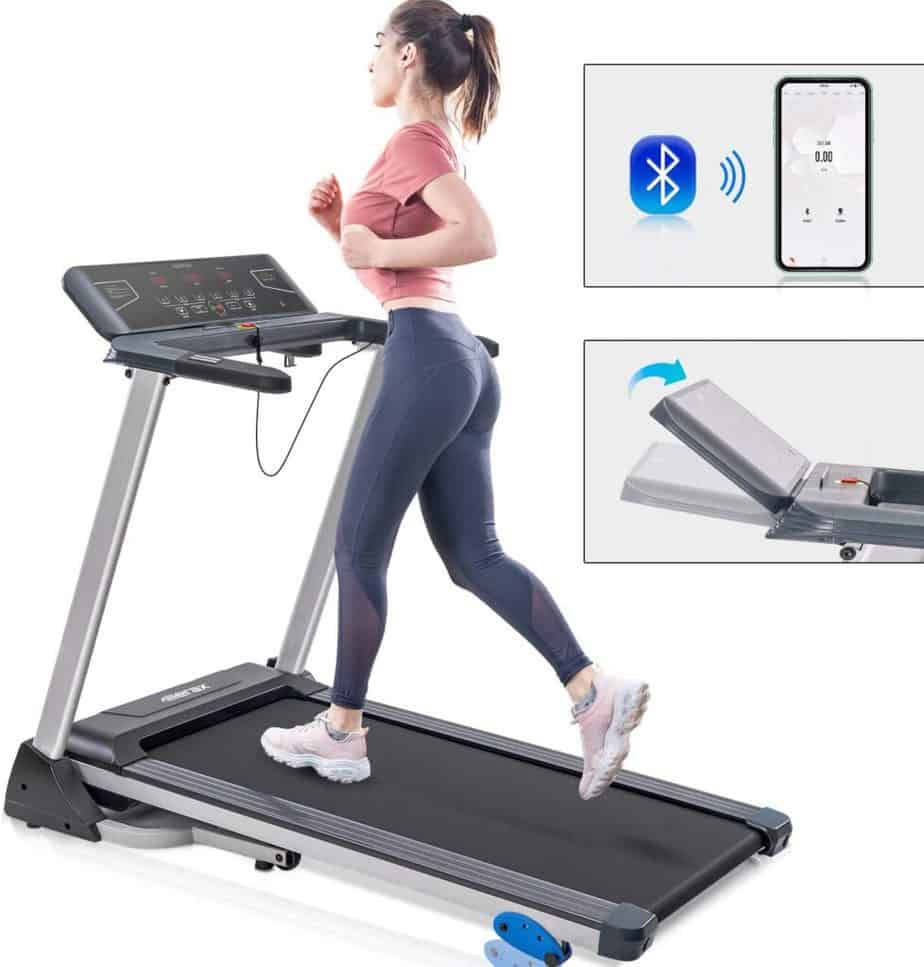 A lady jogs on the Merax Folding Electric Treadmill