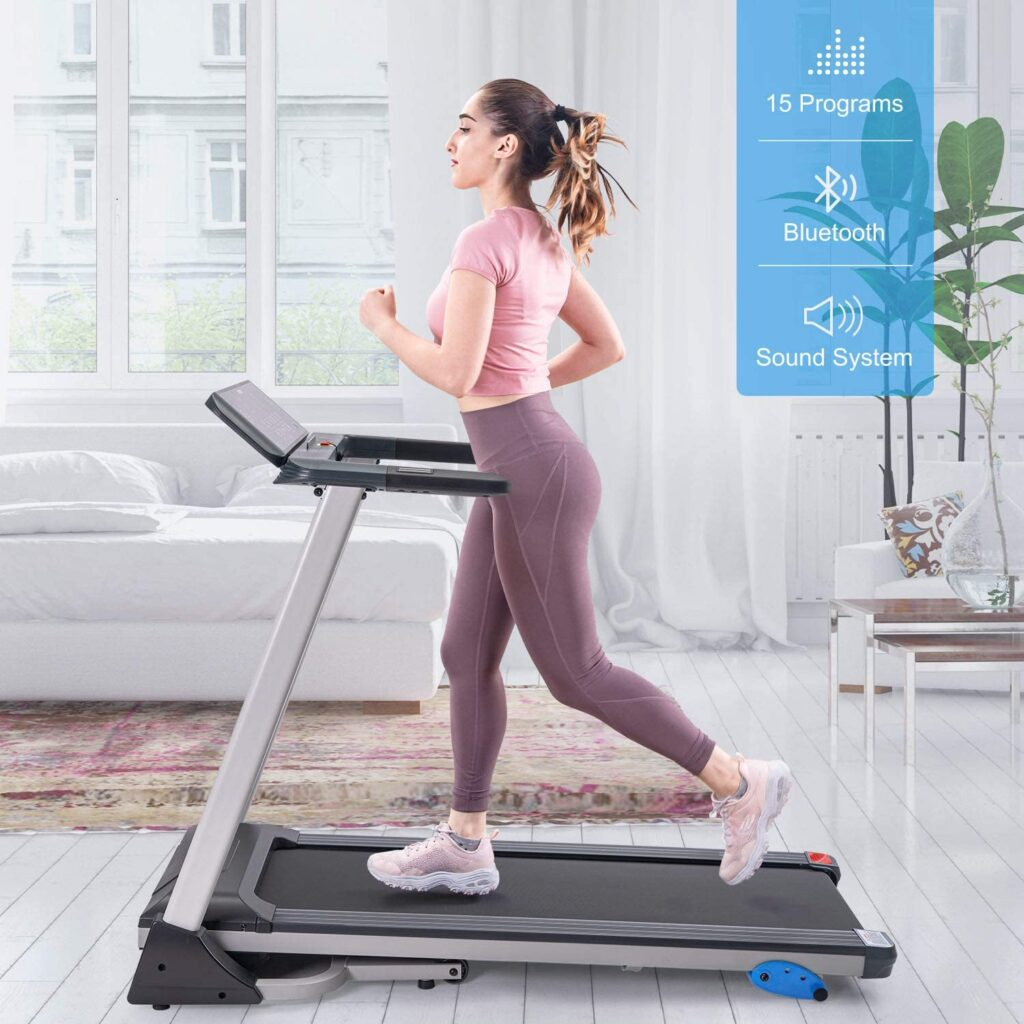 A lady is jogging on the Merax Folding Electric Treadmill