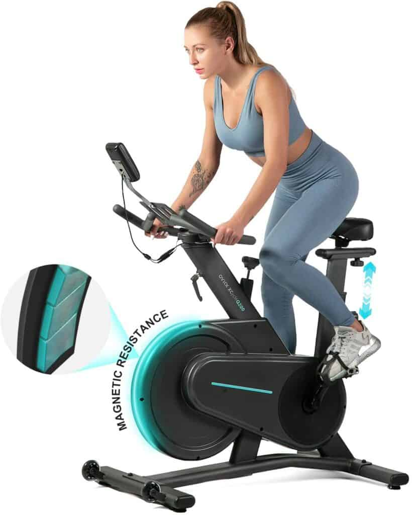 A lady athlete rides the OVICX XCycleQ200 Magnetic Stationary Spin Bike