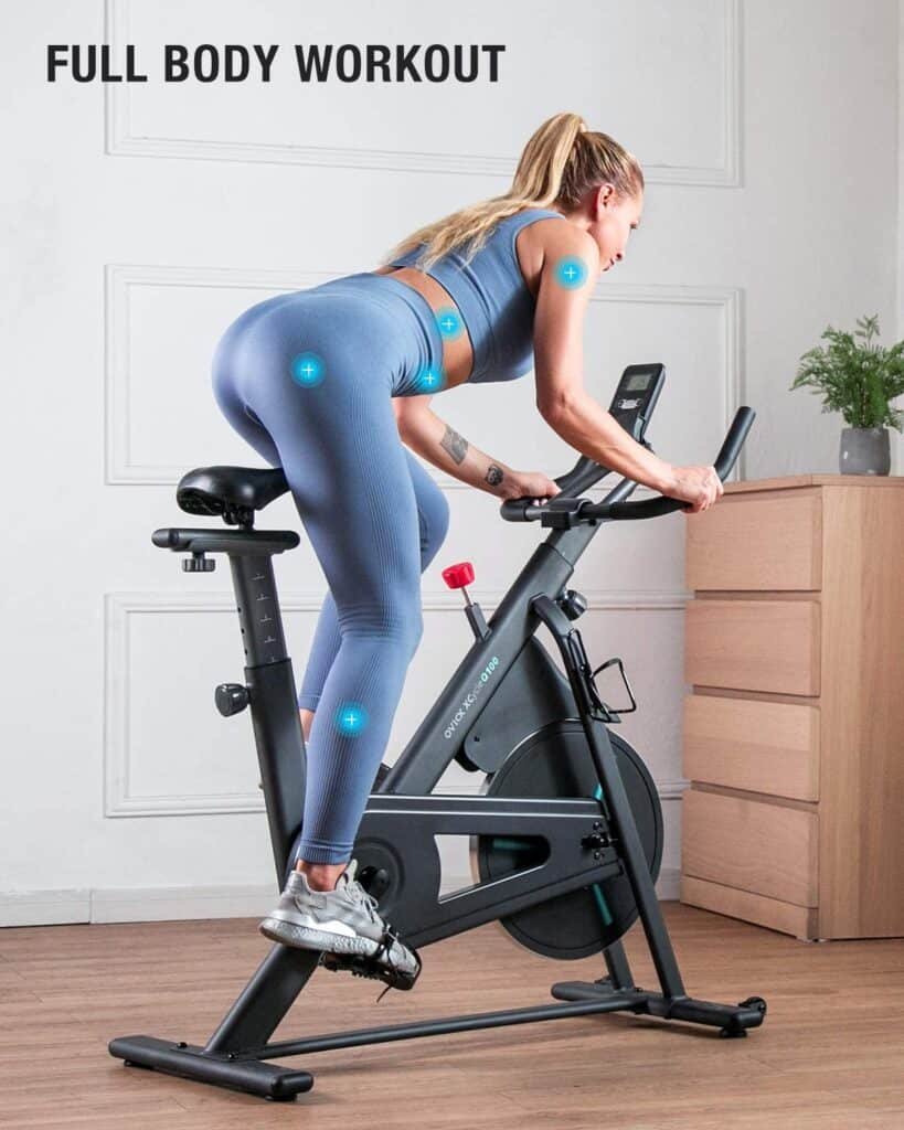 A lady is riding the OVICX XCycleQ100 Stationary Indoor Bike