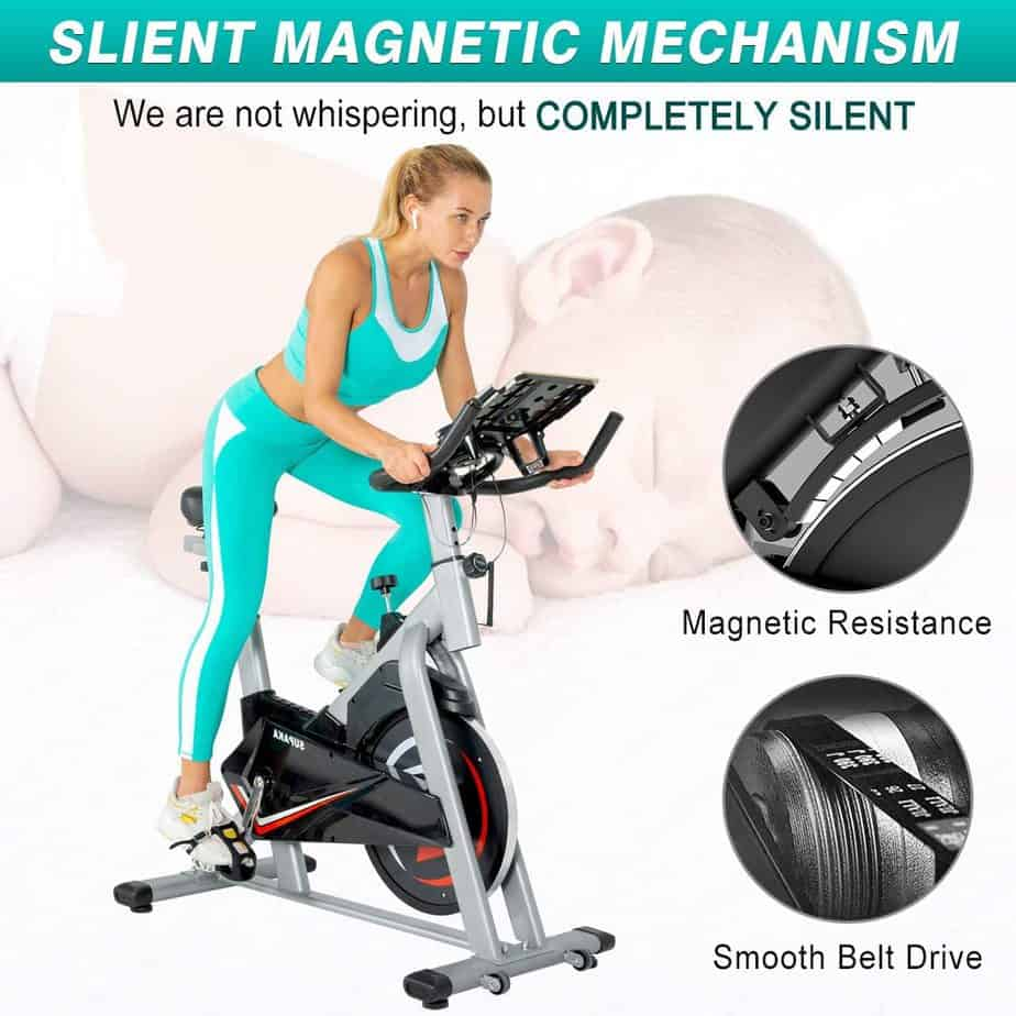 A lady is exercising with the SUPAKA Indoor Magnetic Spin Bike
