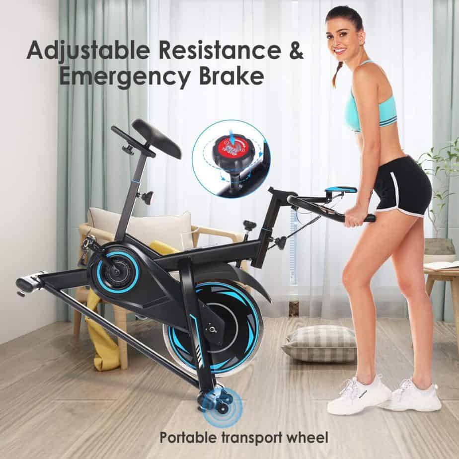 A lady moves the FUNMILY Indoor Stationary Exercise Bike for storage