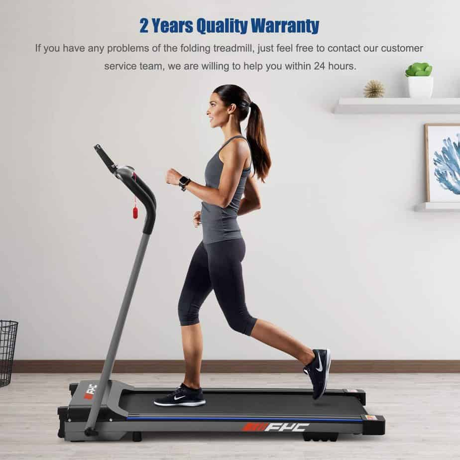 A lady is jogging on the FYC JK1608E-1 Folding Compact Home Treadmill