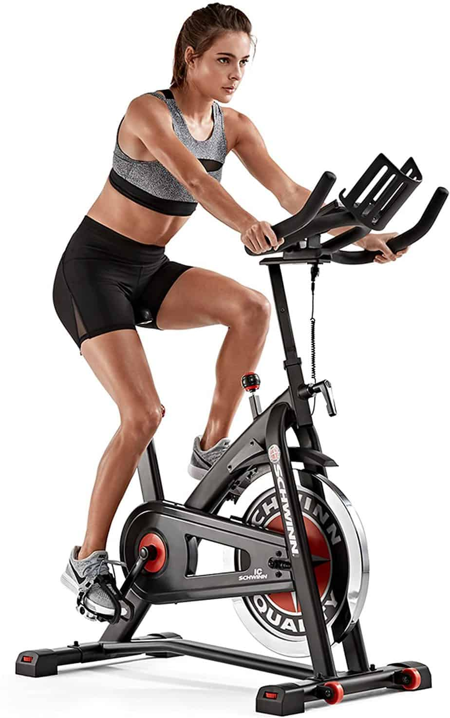 A lady exercises with the Schwinn IC3 Indoor Cycling Exercise Bike