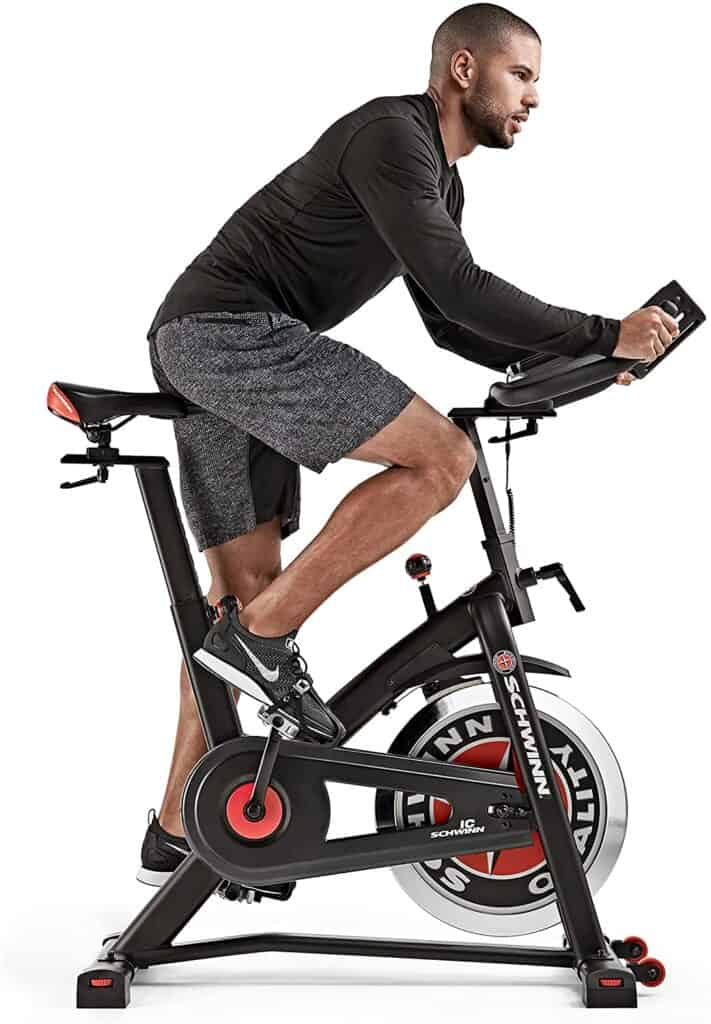A man rides on the Schwinn IC3 Indoor Cycling Exercise Bike