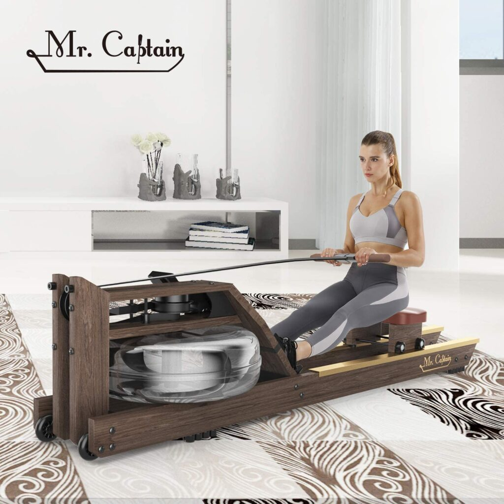 A lady athlete is exercing with the Mr. Captain Water Rowing Machine
