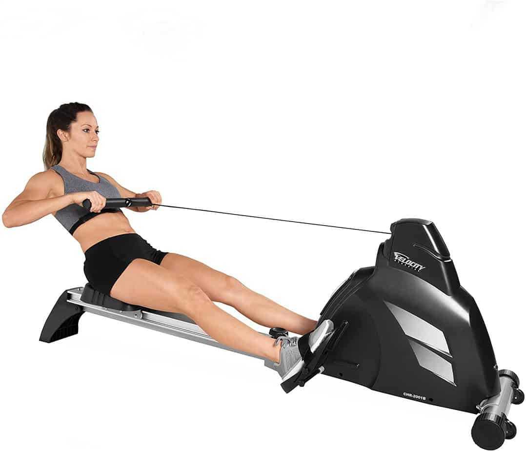 A lady is exercising on the Velocity CHR-2001 Magnetic Rower