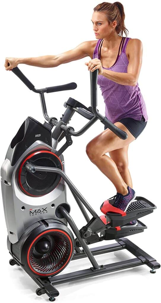 A lady exercising on the the Bowflex Max Trainer M5