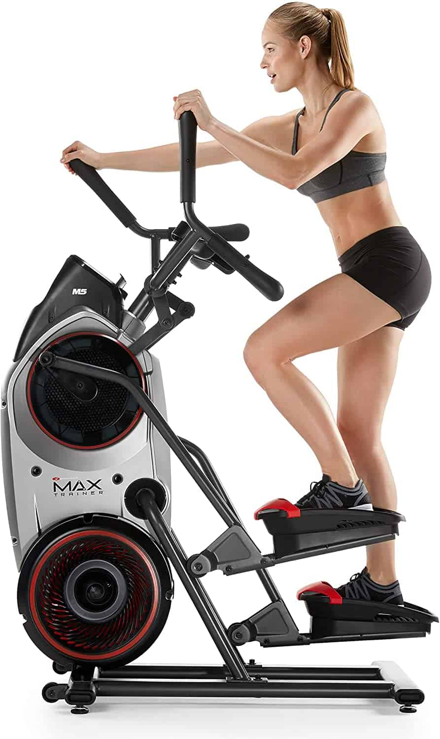 A lady exercises with the Bowflex Max Trainer M5