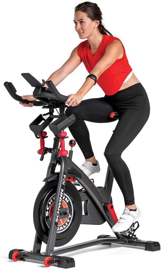 A lady rides the Schwinn IC4 Indoor Cycling Exercise Bike