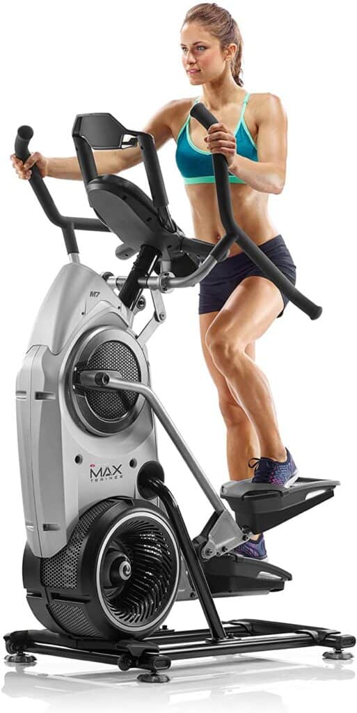 A lady works out on the Bowflex Max Trainer M7