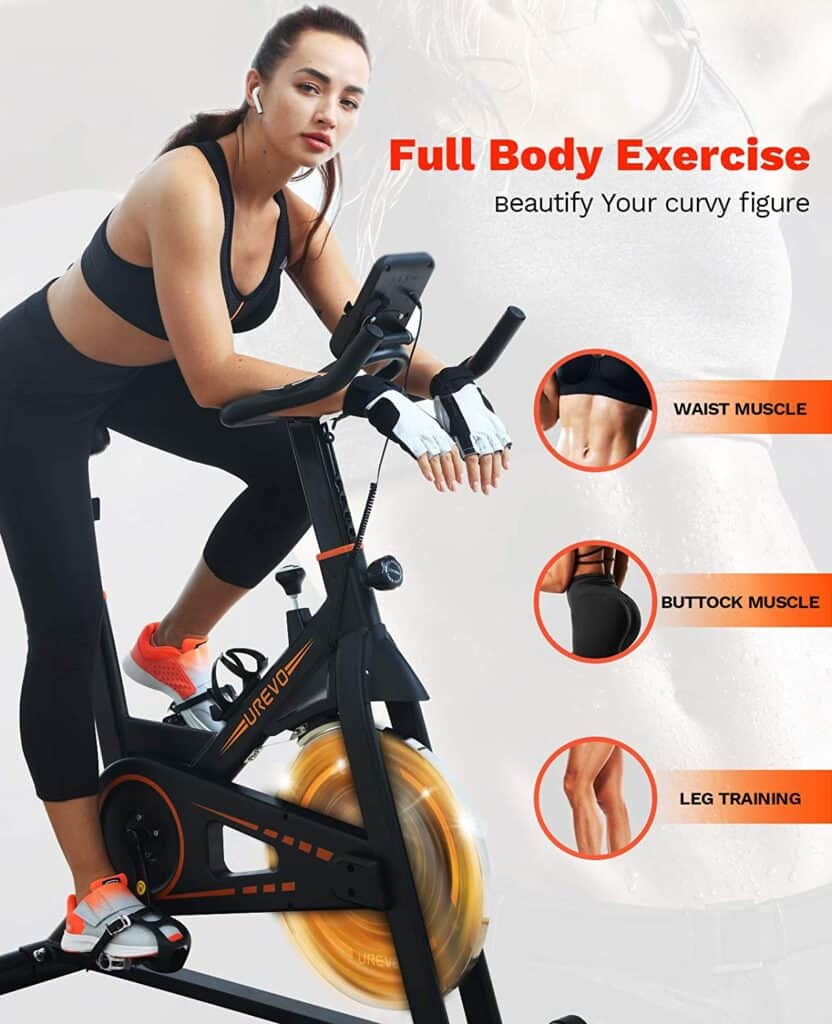 A woman exercises on the UREVO Belt Drive Indoor Cycling Bike